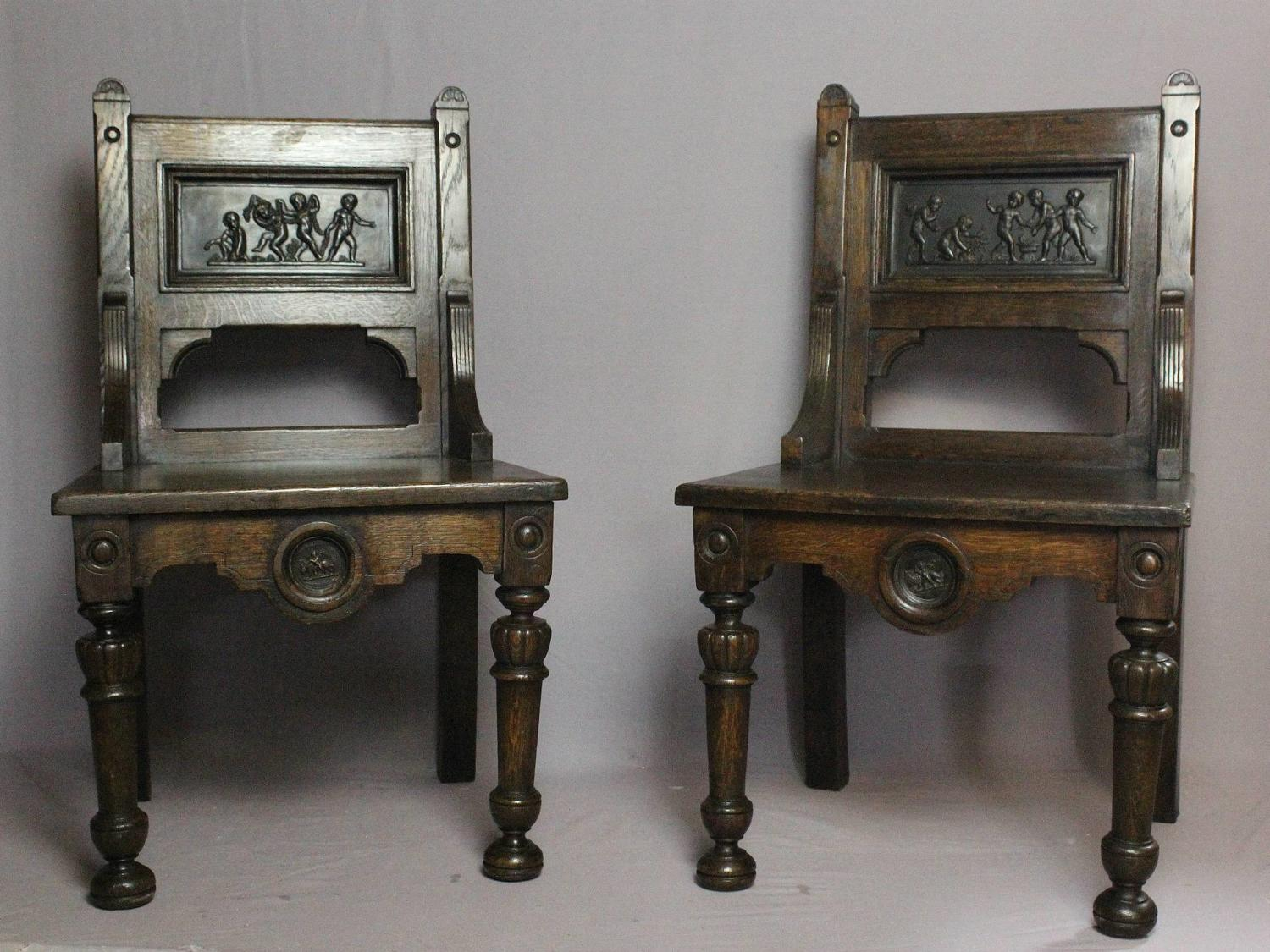 Pair of Oak Hall Chairs inlaid with terracotta plaques