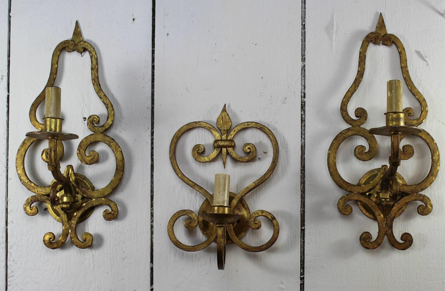 Garniture of Three Gilt Metal Wall Lights