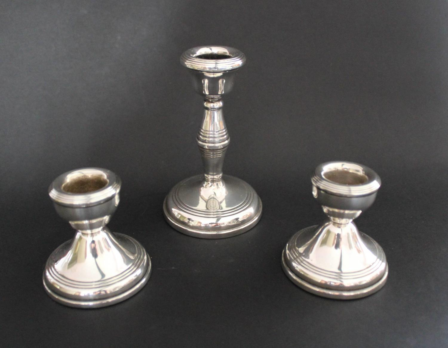 Garniture of Silver Candlesticks