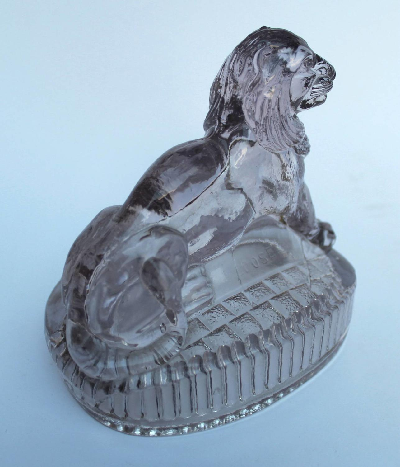 An Antique French Pressed Glass Lion