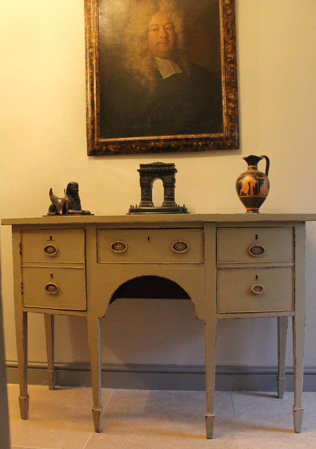 A Small Regency Bowfront Painted Mahogany Sideboard