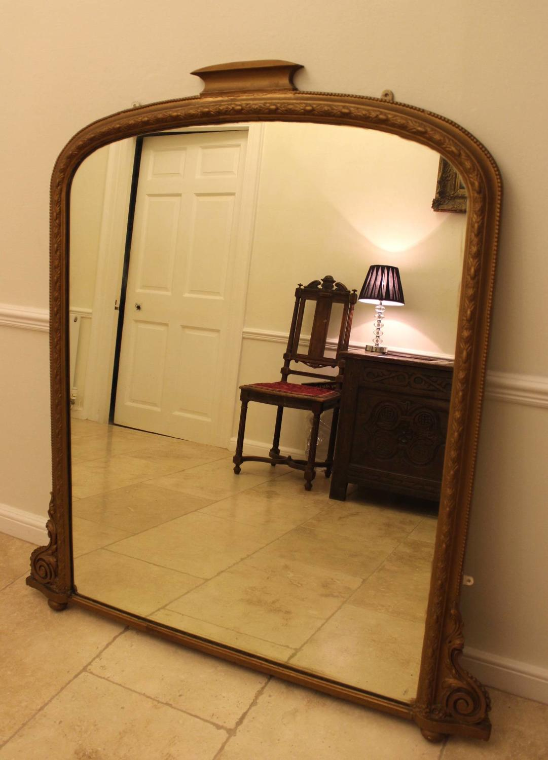 A Large Victorian Gilt Overmantel Mirror
