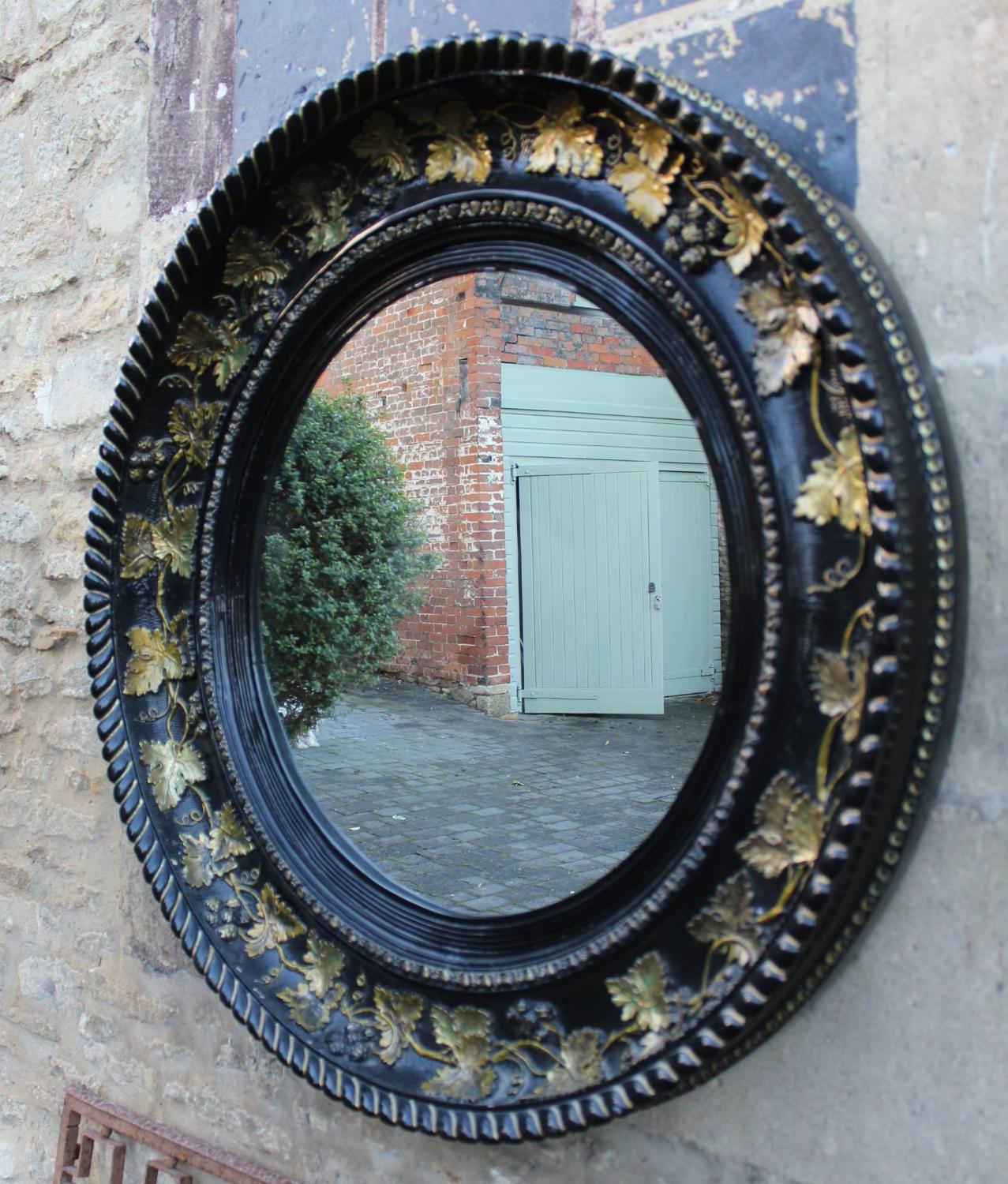 A Large Black & Gilt Circular Wall Mirror