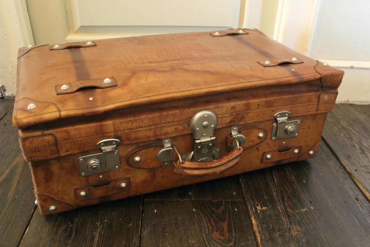 A Vintage Tan Leather Suitcase