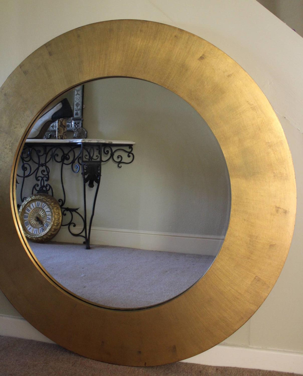 A Very Large Gilded Circular Wall Mirror