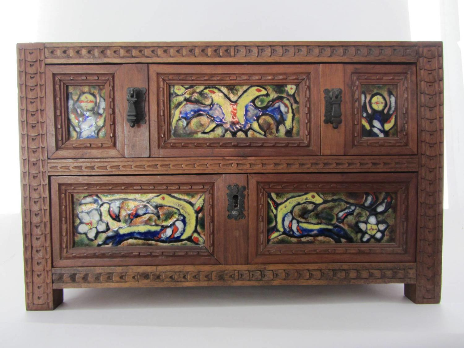 A Scandinavian Miniature Chest of Drawers with Enamel Plaques