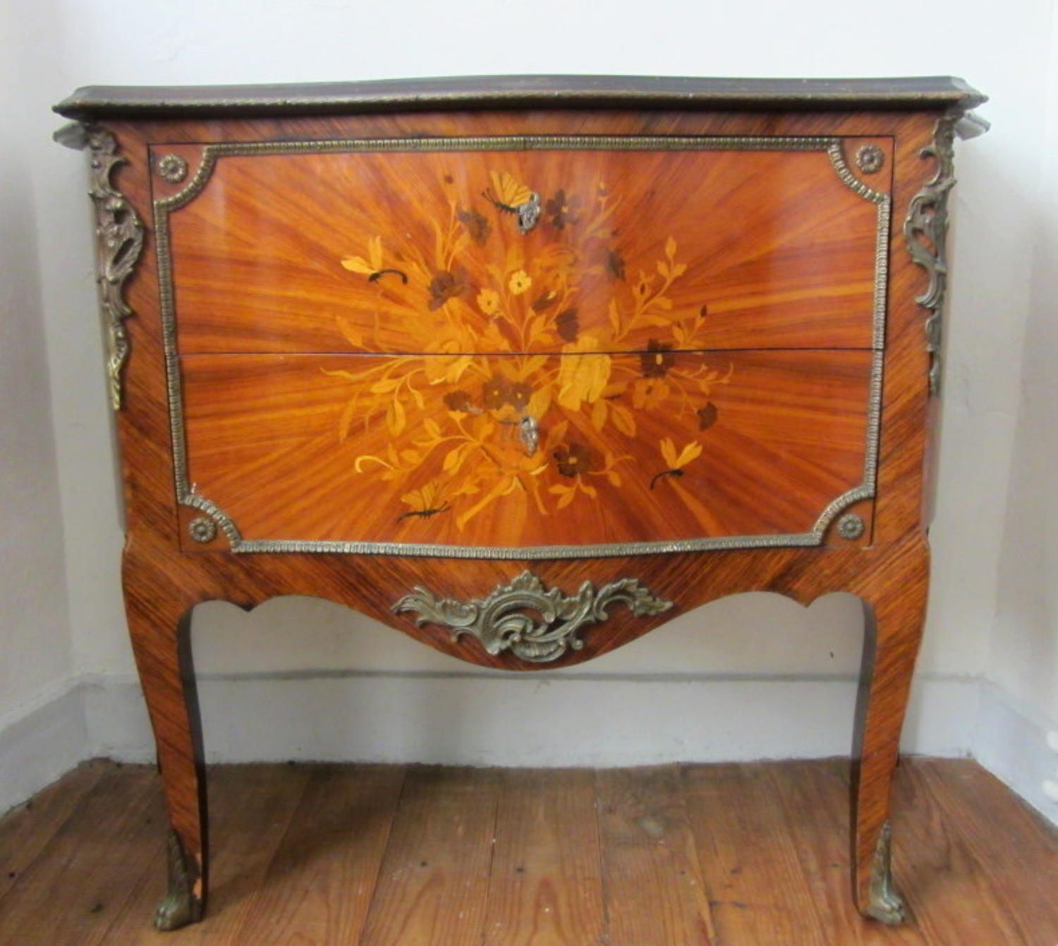 A Louis XV Style Kingwood Marquetry Commode with Gilt Metal Mounts