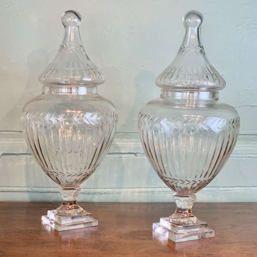 A Large Pair of Cut Glass Shop Display Jars & Covers