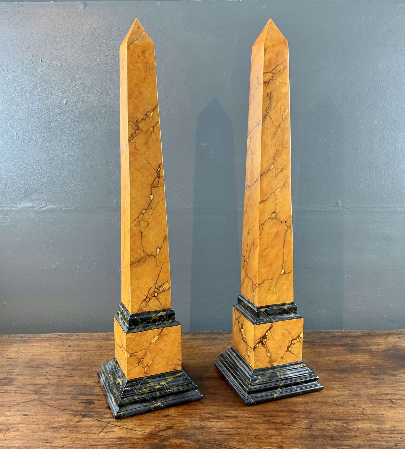 Pair of Faux Siena Marble Obelisks
