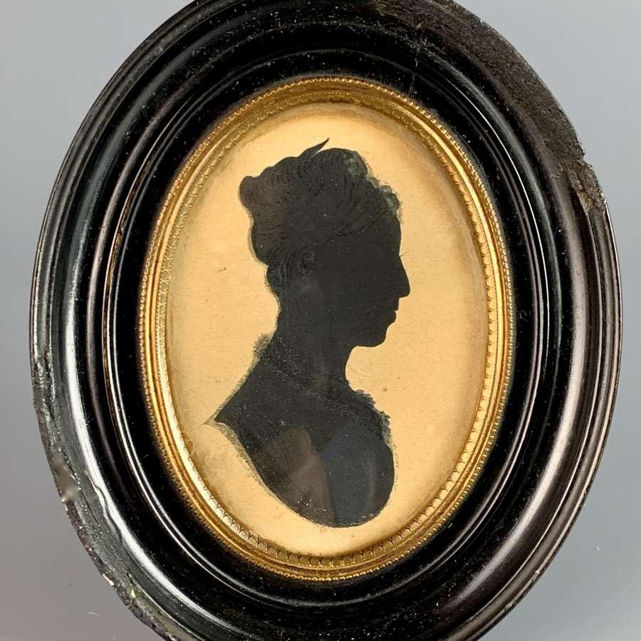 Regency Silhouette of a Lady in an Oval Strut Frame