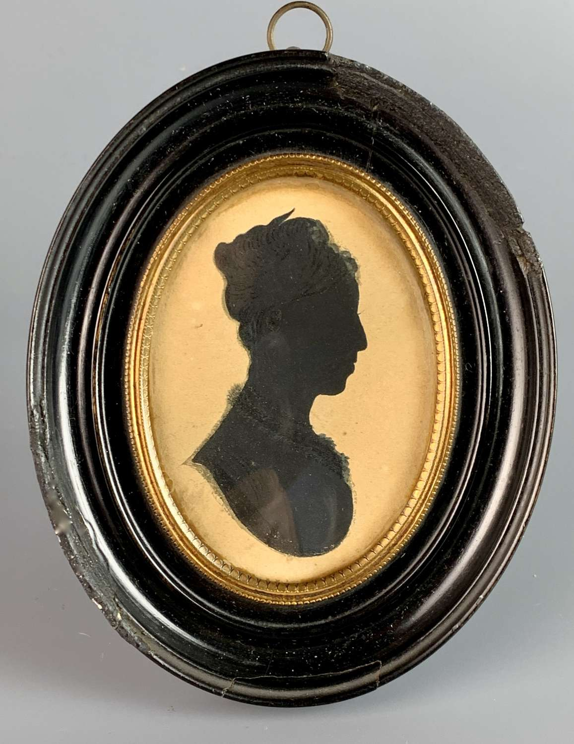 Regency Silhouette of a Lady in an Oval Strut Frame