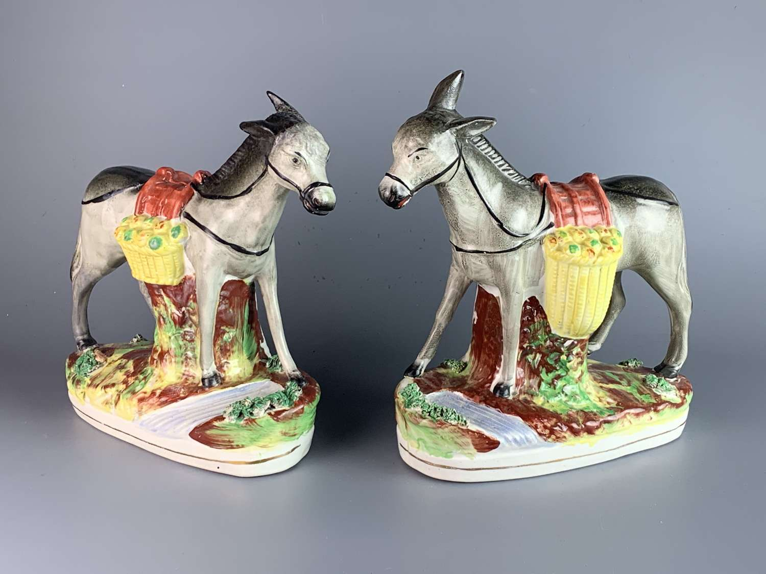 Pair of Victorian Staffordshire Pottery Donkeys