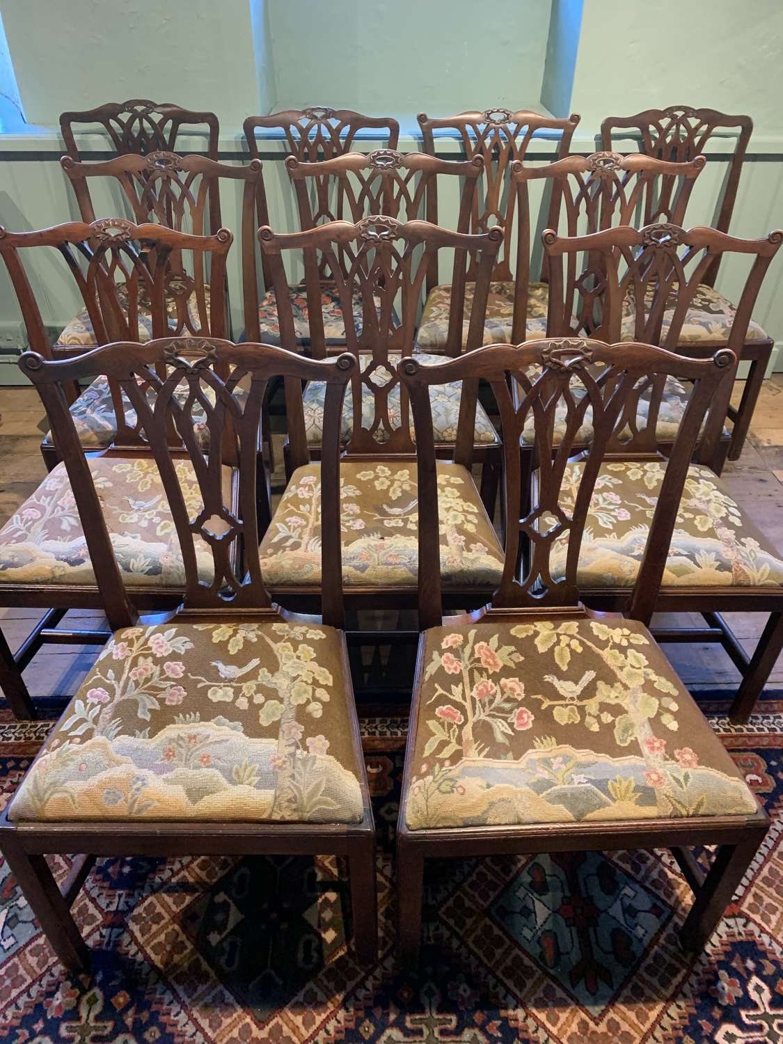 Twelve George III Mahogany Dining Chairs with Needlework Seats