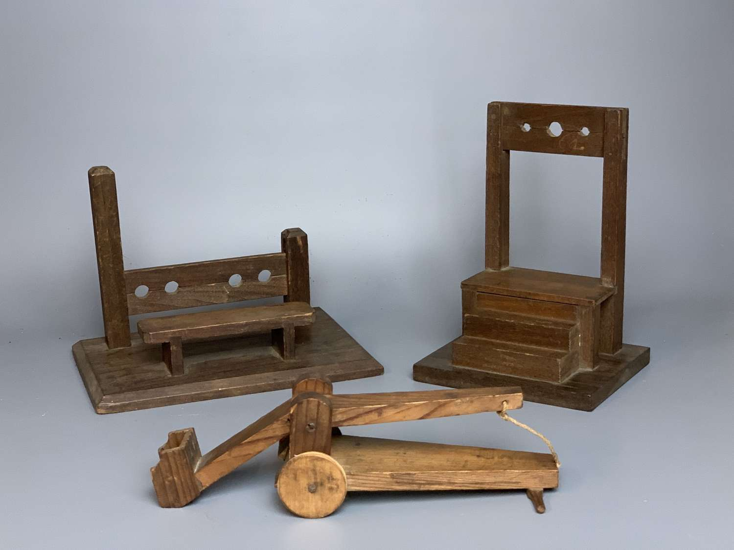 Naive Wooden Models of Instruments of Punishment